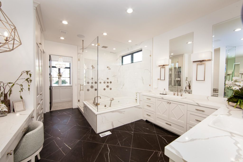 Utah Valley Parade of Homes, The Alpine Swoop, E Builders, Black tile, Granite countertops, Glass shower, Floral design, White cabinets, White countertop