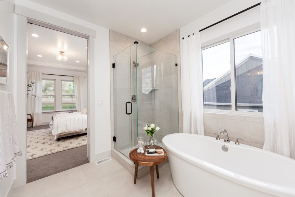 Utah Valley Parade of Homes, Sabrina, EDGEhomes, Freestanding tub, Bathroom accesories, Wooden stool, Glass shower, Bath caddy