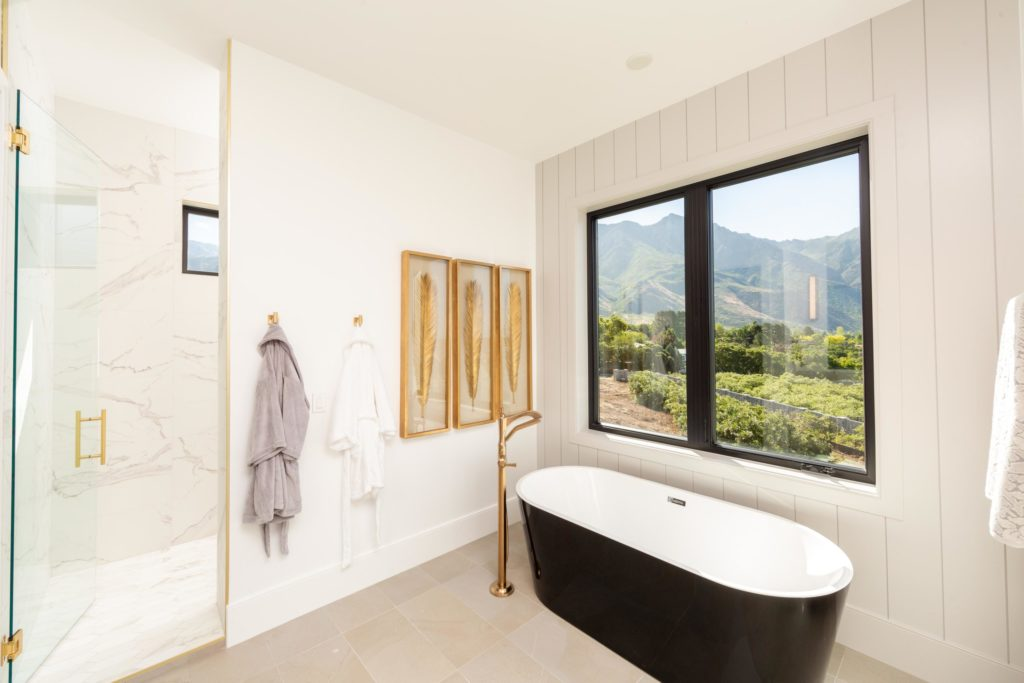 Utah Valley Parade of Homes, Bathroom design, The Ridge at Alpine, Highland Custom Homes, Freestanding tub, Glass shower, Window, Wall art, Bathrobes