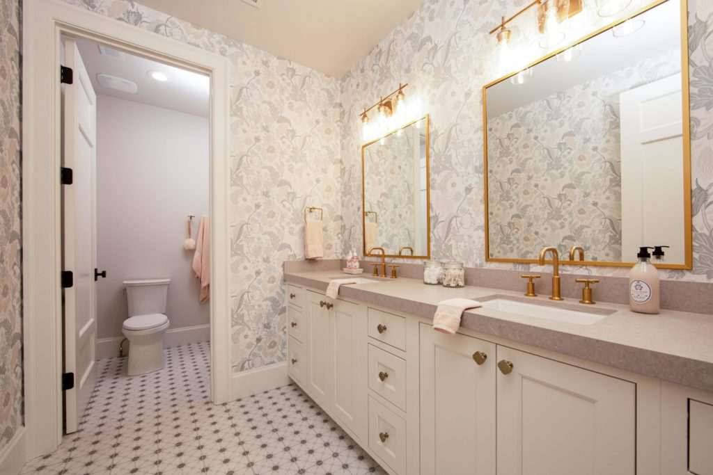 Utah Valley Parade of Homes, Bathroom design, The Haven, Nelson Quality Construction, Floral wallpaper,  Bathroom tile, Countertops, Vanity mirror, Gold-framed mirror, Double sink