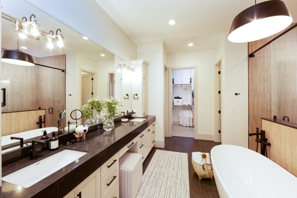 Utah Valley Parade of Homes, Mahogany, R.C. Dent Construction, Bath caddy, Bath accessories, Freestanding tub, Wicker basket, Dark countertops, Overhead lighting