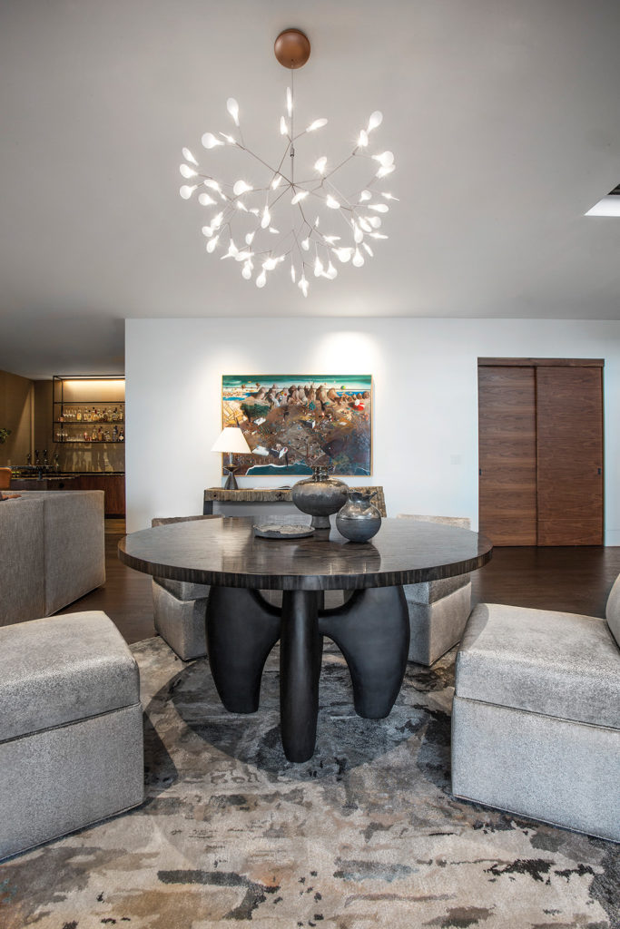 Lower-level family room with Rotary dining table and Tatiana pottery