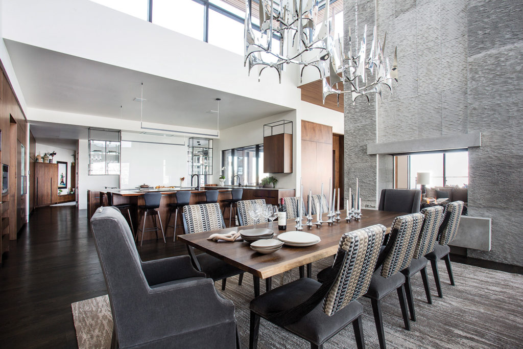 Antler chandelier, Live-edge wood table, Mohair  chairs, Double island, Back-painted glass, Custom cabinets