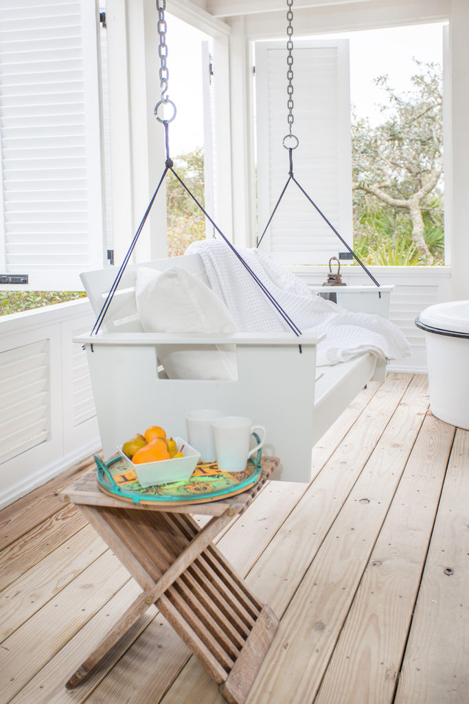 white-on-white porch, swing, wooden side table