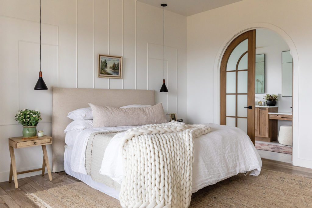 Brad and Hailey Devine, Pencil molding, Linen bedding, Woven rugs, End tables, Pendant lights, Master bedroom