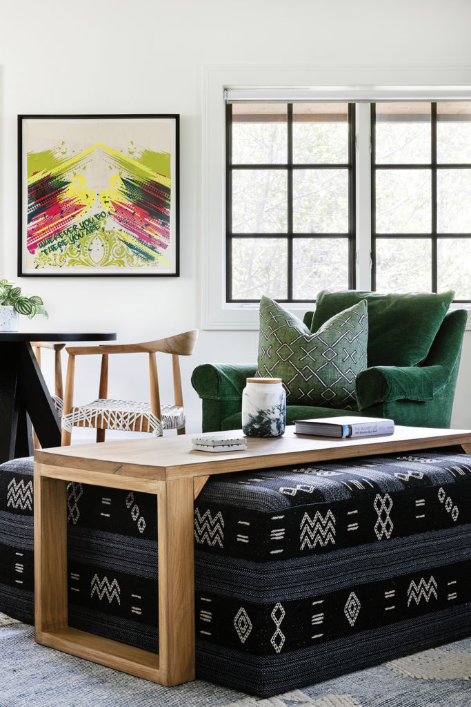 Media room, Sleeper sofa, Screen print on linen, Lounge chairs, Grass-green corduroy, Patterned textile ottoman, Woven rug, Game chairs