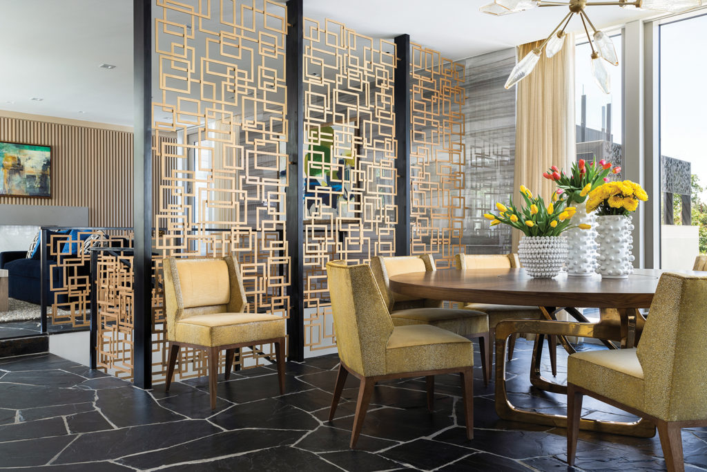 Ron Godwin, dining area, rocky crystal starburst chandelier, see-through geometric screen, yellow chairs, mid-century modern