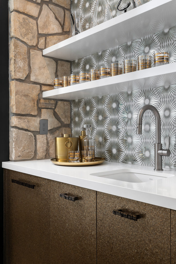 Godwin, wet bar, floating shelves, 50s interior, Constellation Reflections tile and stone, gold glassware