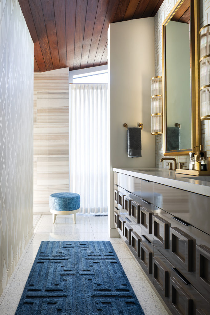 master bathroom, guilded framed mirrors, decorative sconces, 3D geometric drawers, blue and gold accents, brass hardware