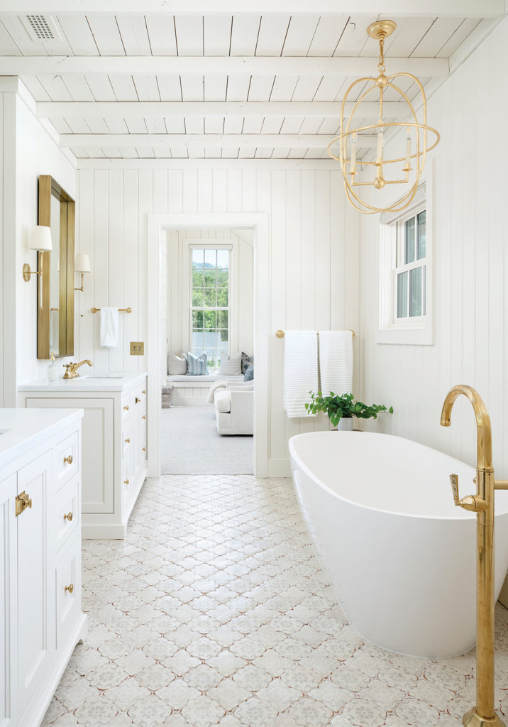 Farm Raised. Master bathroom, honed clacatta marble, brass accents, freestanding tub, hand-painted floor tiles, cream-white color palette, Bodell's