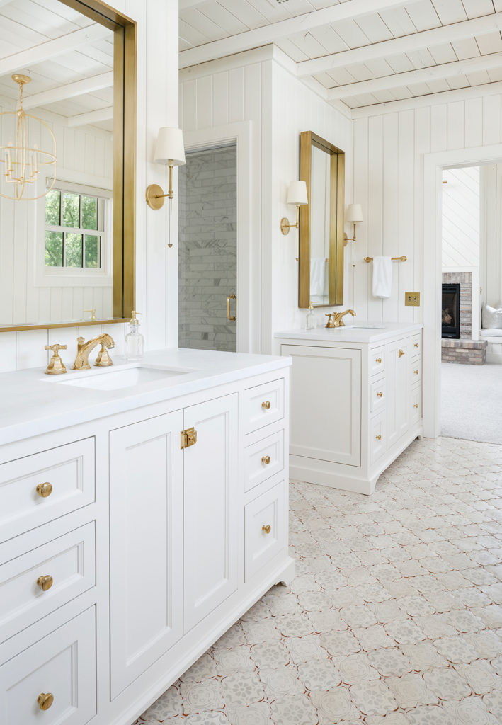 vanity, brass mirrors, brass-and-lucite sconces, un-lacquered brass hardware
