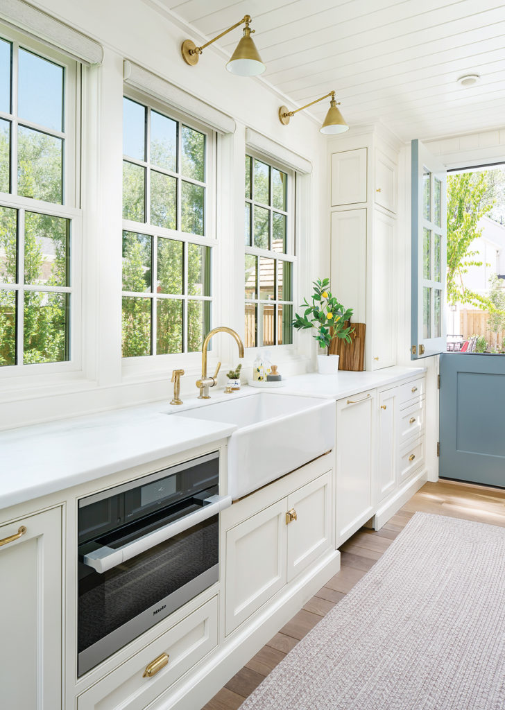 Farm Raised butler's pantry, blue Dutch door, white cabinets, gold hardware, faucet by Waterworks, sconces by Visual Comfort, Bodell's