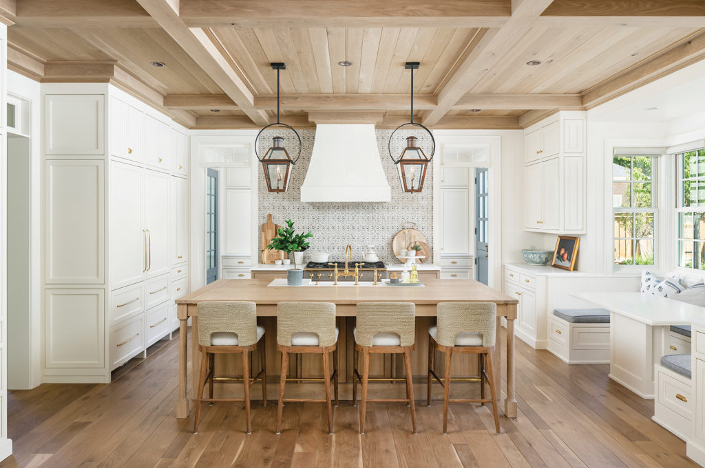 kitchen, oak plank floors, Tabarka tile backsplash, fumed oak beamed ceiling, plaster hood, white custom cabinets, gold hardware, built-in nook table, Benjamin Blackwelder Cabinetry, Bodell's