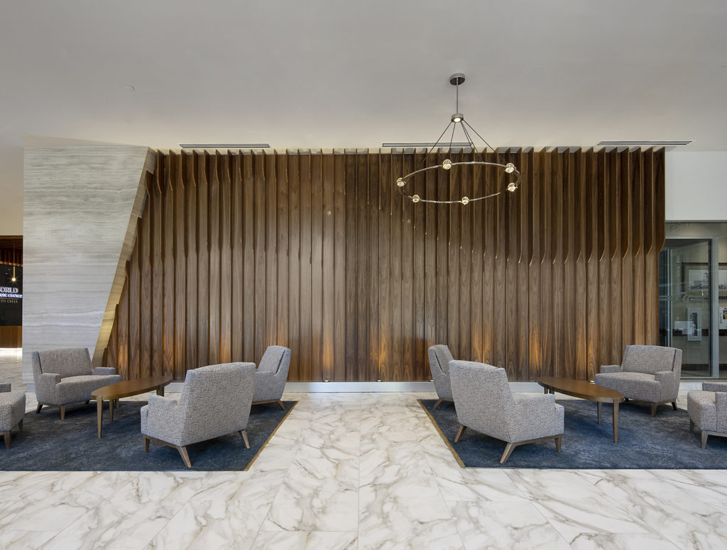 Sitting area with sculpted wood wall in World Trade Center at City Creek